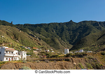 Picturesque small coastal town with houses built in steep hill.