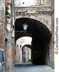 Picturesque street in antique center Siena, Tuscany, Italy