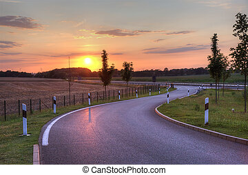 Picturesque sunset on highway in Netherlands, Europe.