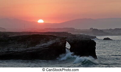 Picturesque sunset over As Catedrais beach in Spain - Beach...