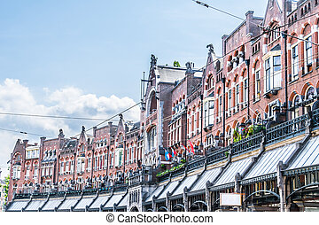 Picturesque traditional Dutch houses in Amsterdam, Holland.