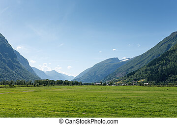 Picturesque valley between mountains with a small village,...