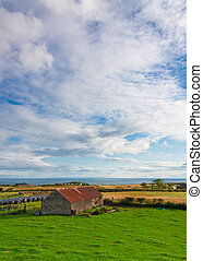 Picturesque view of a barn - Portrait view of a barn in a ...