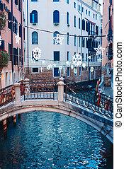 Gondolas on lateral narrow Canal, Venice, Italy.