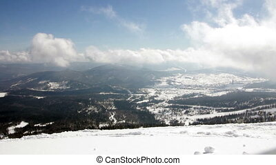 Picturesque view of snowy mountains in sunny day with clowds