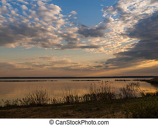 Picturesque view of the river at sunset with cloudy sky