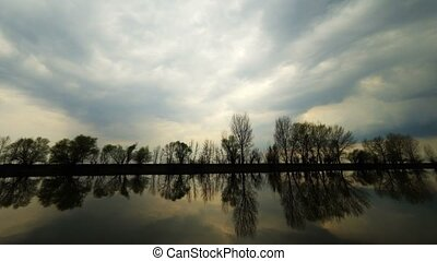 Picturesque view of the river with reflections of the trees...