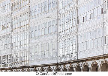 Picturesque white balconies glass facades in A Coruna. Spain