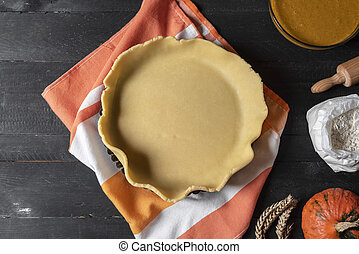 Pie crust in a tray and ingredients