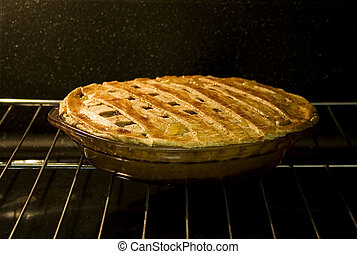 Pie in Oven - Stock photo of pie in the oven, focus on...