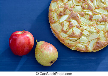 Pie of apples and pears on a gray wooden background