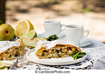 pie, strudel with pear and lemon. Cup of coffee.