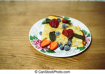 Pie with berries on the plate