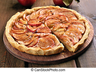 Pie with fresh apples on wooden table