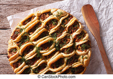 pie with ground meat and vegetables closeup. Horizontal top view