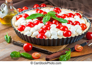 Pie with mozzarella, chicken and tomatoes. Italian food