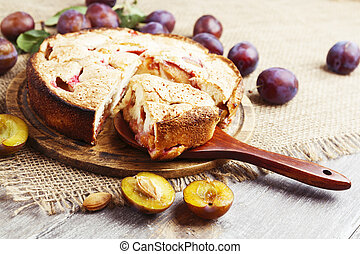 Pie with plums on the table