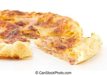 pie with potatoes, ham and mozzarel