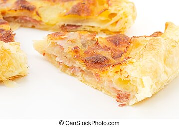 pie with potatoes, ham and mozzarel