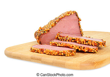 Piece of a ham with spices on a wooden board