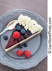 Piece of  berry cake decorated with whipped cream