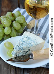 piece of blue cheese, grapes