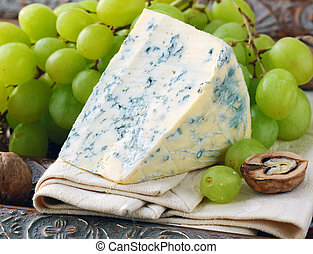 piece of blue cheese with fruits