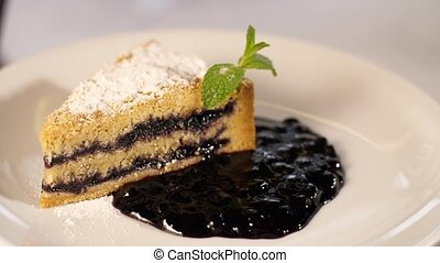 Piece of cake on a plate - piece of blueberries cake on a...