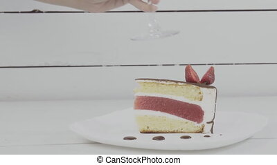 piece of cake on the table - piece of cake and a glass of...