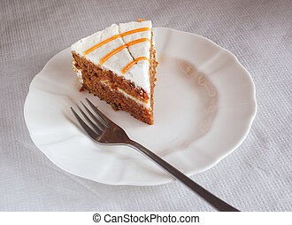 cake on a plate - piece of carrot cake on a plate