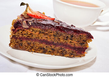 piece of carrot cake with cup of tea. close up