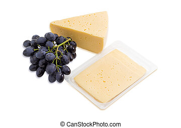 Piece of cheese, sliced cheese and bunch of grapes