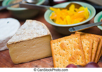 Piece of cheese with biscuits