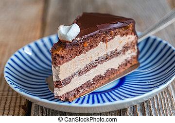 Piece of chocolate cake Prague close up.