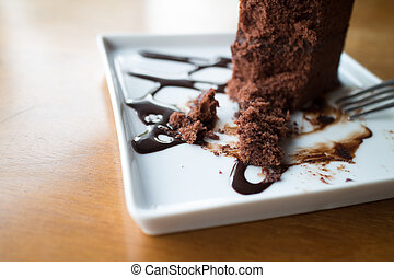 Piece of chocolate cake with warm chocolate syrup