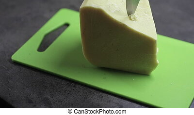 piece of cocoa butter is cut with a knife