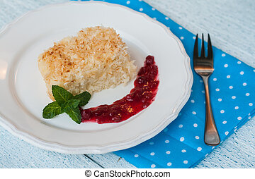 piece of coconut cake with berry jam