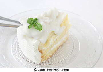 piece of delicious cake with slice coconut