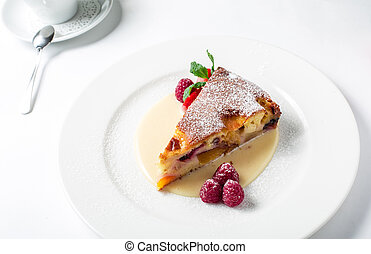 Piece of delicious clafoutis with nectarine and plum, served...