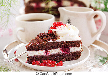 Piece of fresh homemade Black Forest cake with cherry and...