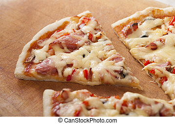 pizza on a wooden background