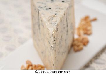 gorgonzola cheese fresh cut and pinenuts - piece of Italian ...