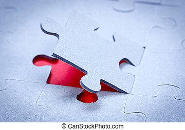 Piece of jigsaw revealing red background