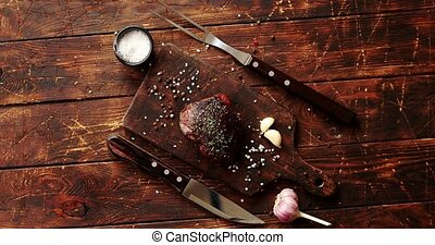 Piece of meat on chopping board - From above view of piece...