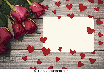 Piece of paper in the middle of felt hearts