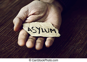 piece of paper with the word asylum