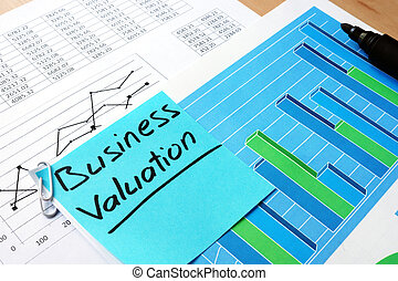 Piece of paper with words business valuation. - Piece of...