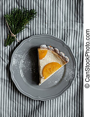 Piece of pie with persimmon on a plate