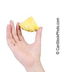 Piece of pineapple in hand.