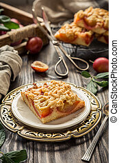 Piece of plum pie with crumble.